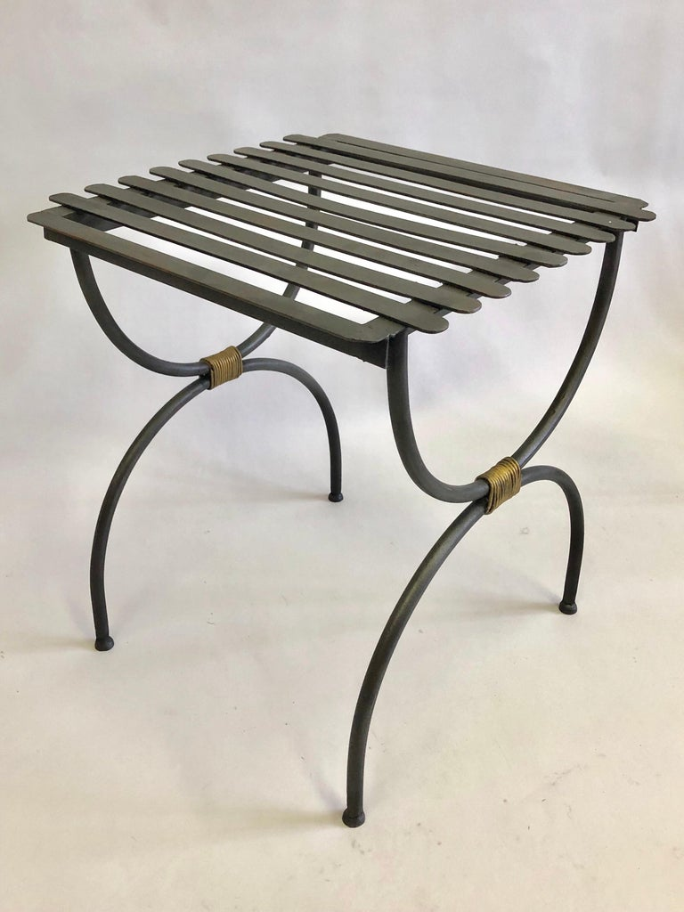 2 pairs of French Mid-Century Modern neoclassical handwrought iron and partially gilt benches, stools or luggage racks circa 1937-1940 in the spirit of Jean Michel Frank. The pieces feature a Classic, sober X-form or Curile Form leg structure and