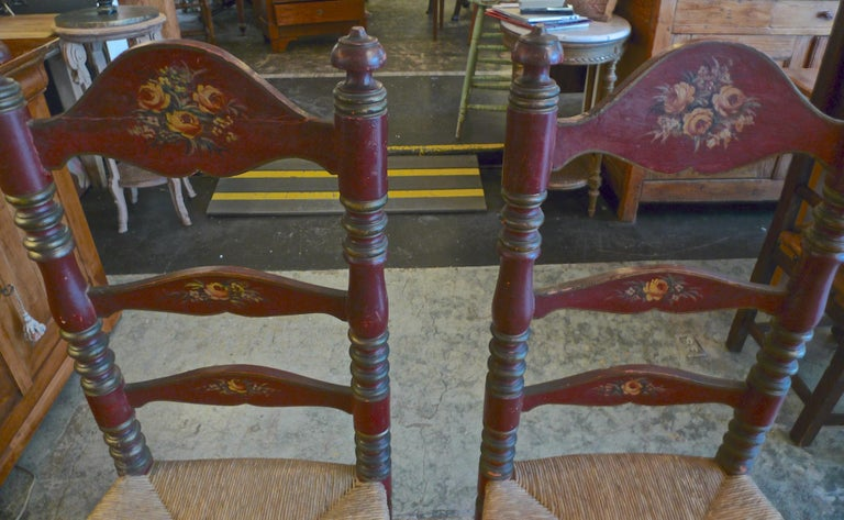 2 Portuguese Painted Ladder Back Side Chairs with Rush Seat and Flower Motif In Distressed Condition For Sale In Santa Monica, CA