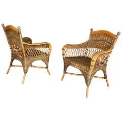 2 Rattan Armchairs, and Their Cushions, circa 1970-1980