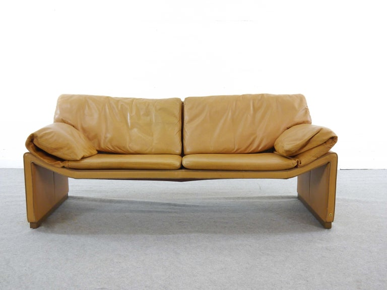 Rare lounge sofa from the 1980s. Manufacturer and designer: Etienne Aigner, famous for highend handbags and shoes. Upholstered in cognac leather. Marked with writing on the fabric and emblem.