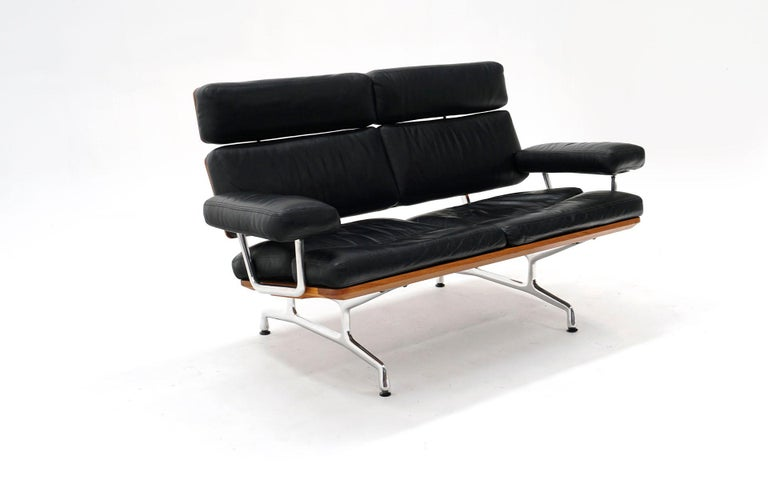 Eames two seat sofa loveseat for Herman Miller. Early production. Black Leather and solid walnut. The Eames sofa is the last piece of furniture produced by the Eames Office, which completed the design after Charles Eames died in 1978. It went into
