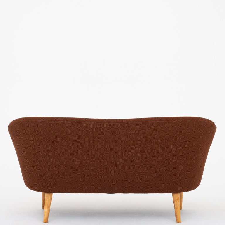 Reupholstered 2-seat sofa in new fabric (Colline 568) with legs of beech. Unknown maker.
