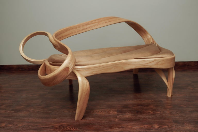2 seats is a limited edition design, only 15 pieces will be handcrafted. In this statement piece, the studio has explored the limits of bending wood.   The main element of the piece is the back where the whole design converges to create a bigger