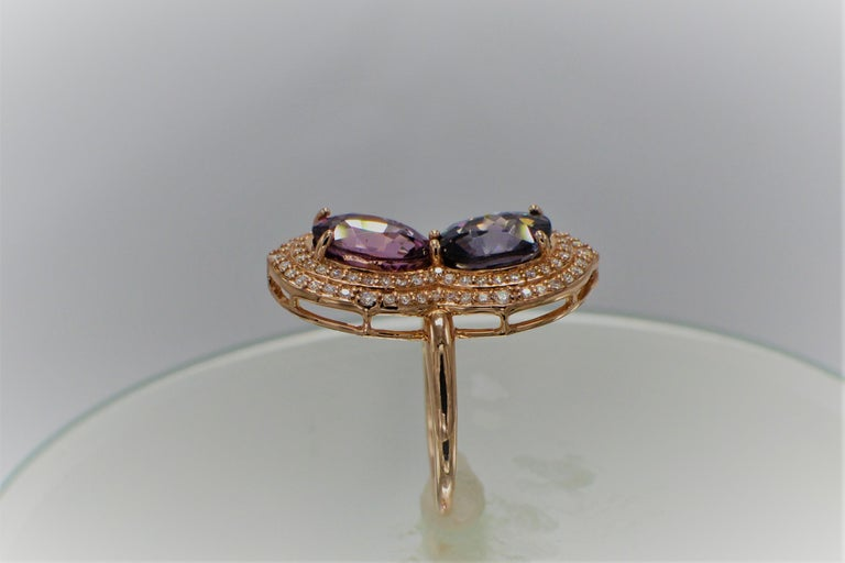 Brilliant 2 - Stone Pink and Blue Spinel Ring. Two oval  shape total 5.65 carat. 14k Rose Gold  4.75 grams,  Total diamonds 0.40 carat FG-VVS . Finger size 7 all stones are natural - and none heated or treated,