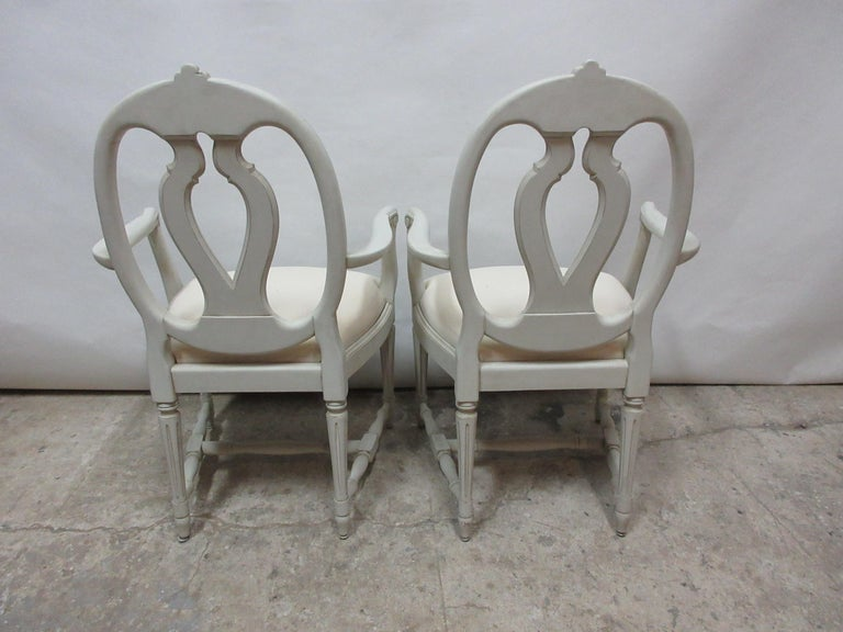 This is a set of 2 Swedish Gustavian armchairs . They have been restored and repainted with Milk paints