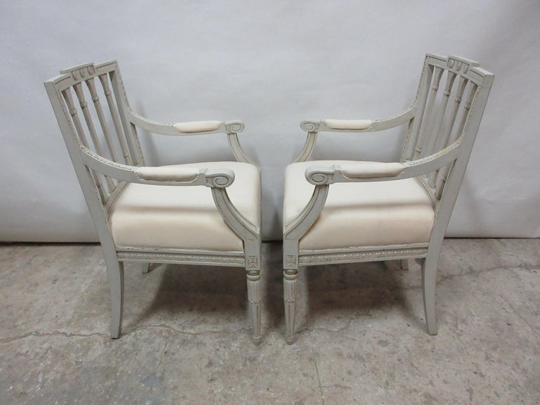 This is a set of 2 Swedish Gustavian armchairs. They have been restored and repainted with milk paints