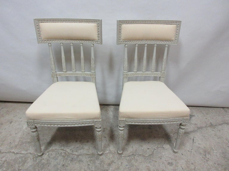 This is a set of 2 Swedish Gustavian side chairs. They have been restored and repainted with milk paints