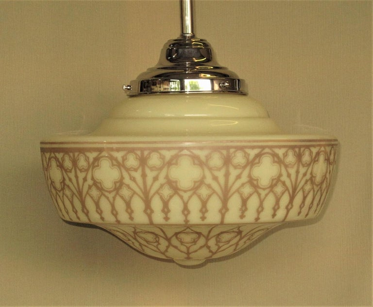 Priced for the pair. Large and opulent fixtures out of a church in the Mid-west we were told. Divine Art Deco inspired design with trefoils, quatrefoils, Moorish arches, and a delicate latticework Surrounding the globe. The soft tan colored design
