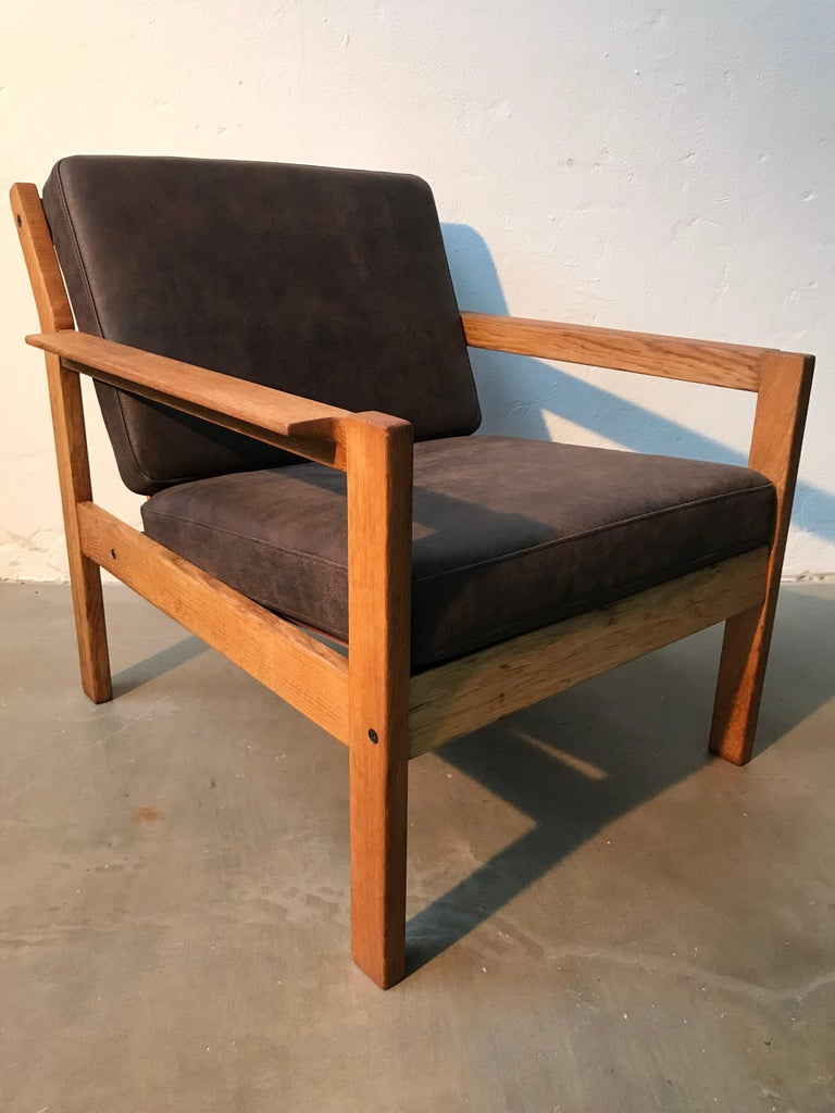 2 vintage oak easy chairs designed by the Danish architect Erik Wørts for FDB of Denmark.