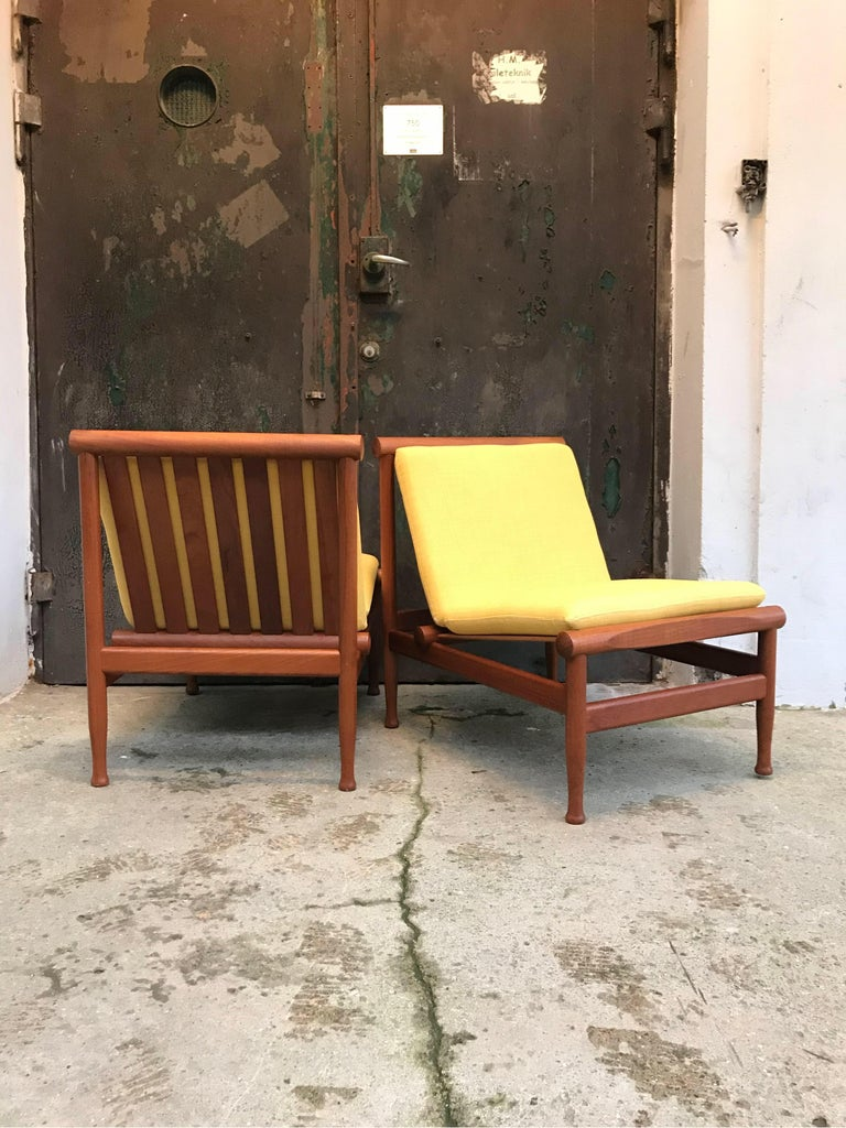 A stunning and rare vintage pair of Kai Lyngfeldt Larsen easy chairs model 501 also known as the Japan chair and made by Søborg Møbler in Søborg, Denmark (my town). These chairs originally from a government building are in fantastic original