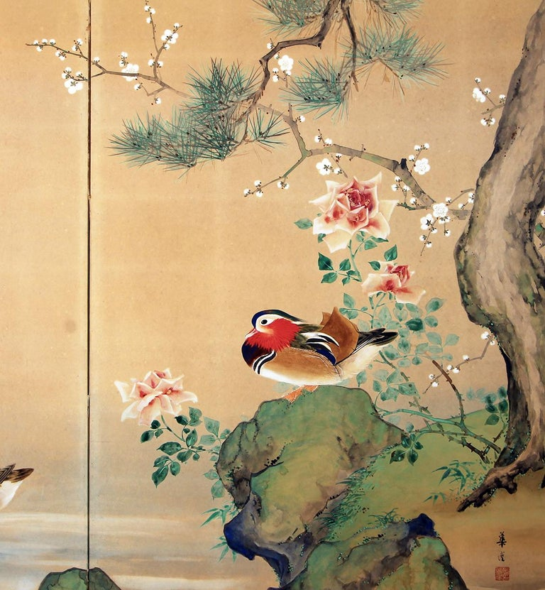 Japanese folding screen with two panels depicting mandarin ducks in a lake setting with pine trees and roses.