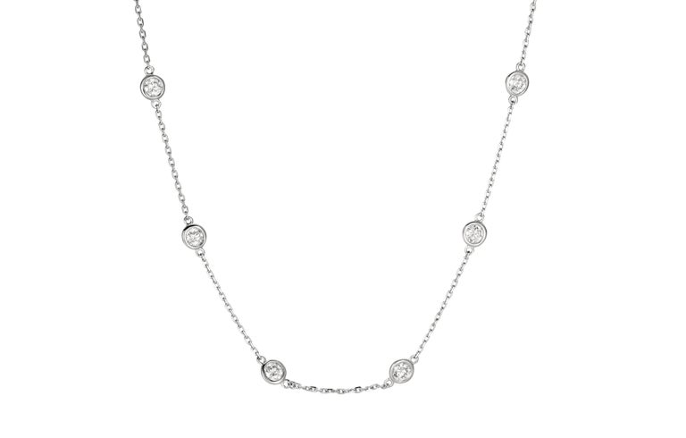 2.00 Carat Diamond by the Yard Necklace G SI 14K White Gold 14 stones 18 inches      100% Natural Diamonds, Not Enhanced in any way Round Cut Diamond by the Yard Necklace       2.00CT     Color G-H      Clarity SI       14K White Gold, Bezel style