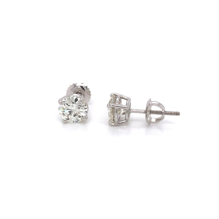 Diamond Stud Earrings made with real/natural brilliant cut diamonds. Total Diamond Weight: 2.02cts. Diamond Quantity: 2 round diamonds. Color: J-K. Clarity: VS. Mounted on 18 karat white gold screw back setting.