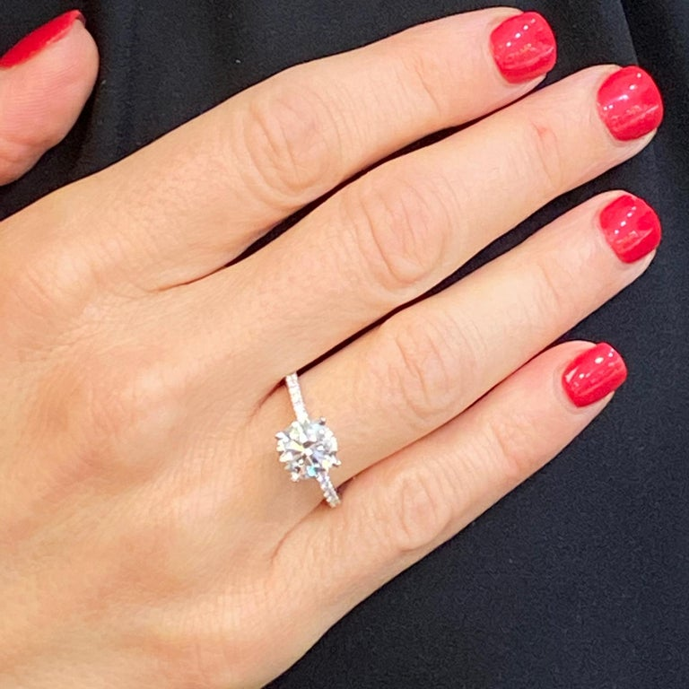 Gorgeous high quality diamond engagement ring fashioned in 18 karat white gold. The round brilliant cut diamond weighs 2.00 carats and is graded D color,  SI1 clarity, and triple excellent cut, symmetry, & polish by the GIA. The mounting features