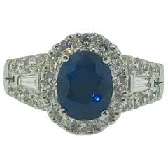 2.00 Carat Sapphire with 1.00 Carat Diamond Halo 18 Karat Ring, Blue Sap