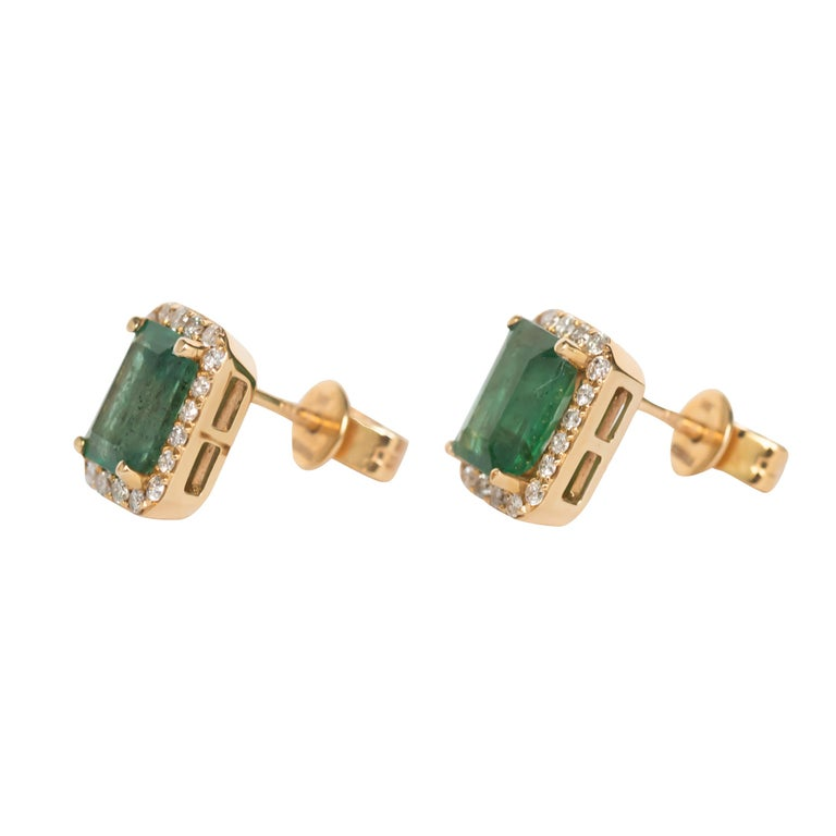 Item Details:  Length: .83 inches  Metal Type: 14 karat Yellow Gold  Weight: 2.4 grams  Color Stone Details:  Type: Natural Emerald  Shape: Colombian Origin Carat Weight: 2.00 carat, total weight.   Side Stone Details:  Shape: Round Brilliant  Total