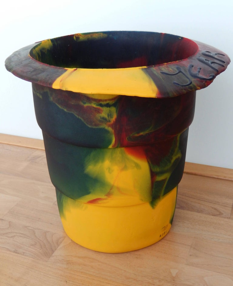 A multicolored resin bucket commemorating the Millennium by the avant-garde Italian architect Gaetano Pesce (b. 1939). Pesce has cleverly incorporated