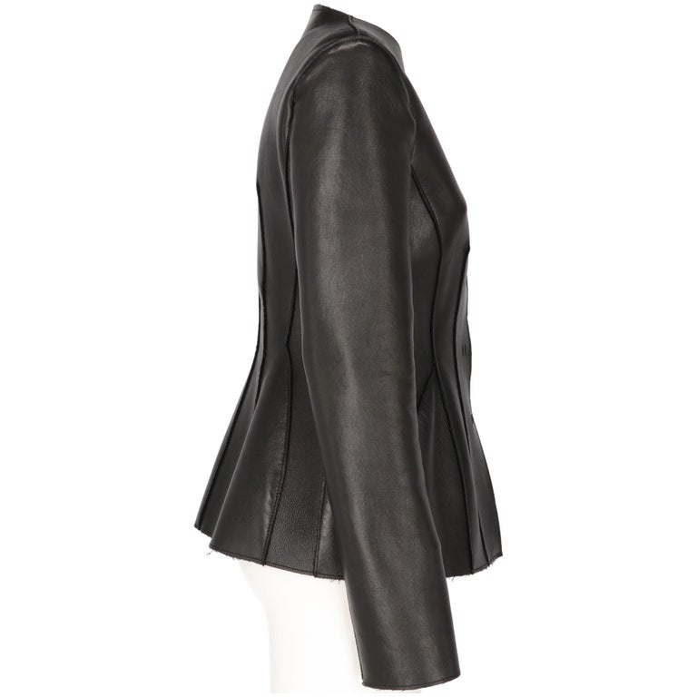 The stylish Alberta Ferretti black leather waist fit jacket features a large round neckline, with front buttoned fastening and decorative visible stitchings and raw edges. Years: 2000s  Made in Italy   Size: 42 IT  Linear measures  Height: 64