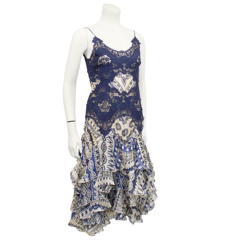 Alexander McQueen cocktail dress from the early 2000's. Blue lace bodice on top of printed chiffon. Drop waist cascades into flounces of layered chiffon. Zipper up centre back. Excellent vintage condition. Fits like a US size 4. Perfect for an early