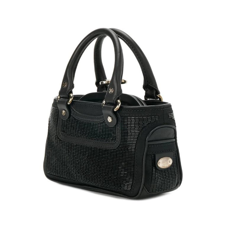 Céline modular handbag in leather and fabric covered with beads with two handles and details in silver metal. Internal clutch with clip closure and internal patch pocket.  The bag has slight signs of wear on the metal and on the fabric