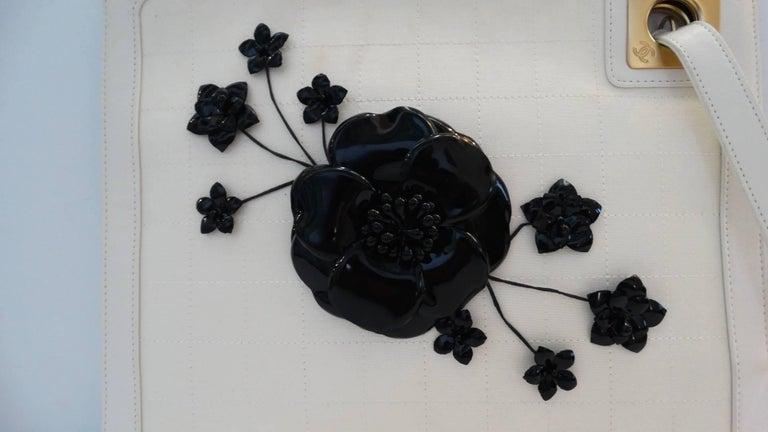 Women's 2000s Chanel Camellia Cream Leather Wristlet  For Sale