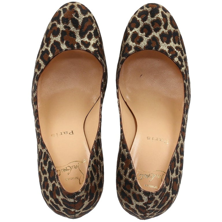 The stylish Christian Louboutin brown black and gold animalier printed lurex leather decolleté features round toes and 11cm stiletto heels.   Made in Italy Years: 200s  Size: 38.5  Heels: 11 cm Plateau: 1 cm Insole: 25 cm