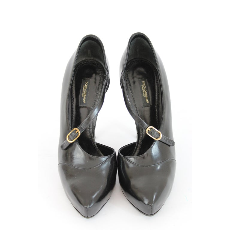 Dolce & Gabbana vintage women's shoes. Decollete black, 100% patent leather. High heel, closure with adjustable band. Code: 1196.2000s. Made in Italy. Excellent vintage conditions.  Size: 37 It 6.5 Us 4 Uk  Heel height: 12 cm