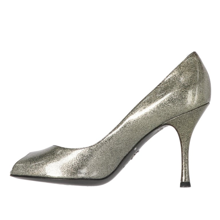 Dolce & Gabbana shiny silver-tone glitter plastic open toe pumps with stiletto heel. Absolutely fabulous to enrich your classy and fashionable outfits. They features a leather insole.  The item shows some very light stains, as shown in the