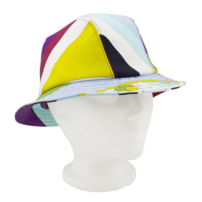 Emilio Pucci neoprene bucket hat from the 2000's. Iconic multicolour abstract Pucci print with markings. Maroon interior & top stitching. Excellent vintage condition - small, faint mark on front. 21.5