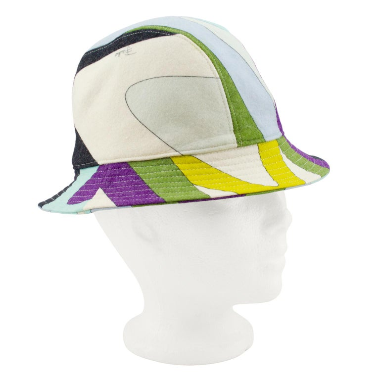 Emilio Pucci wool bucket hat from the 2000's. Weight of wool is perfect for fall and winter. Iconic multicolour abstract Pucci print with markings. Cream top stitching. Good vintage condition - small fit, faint mark on front. 21.5
