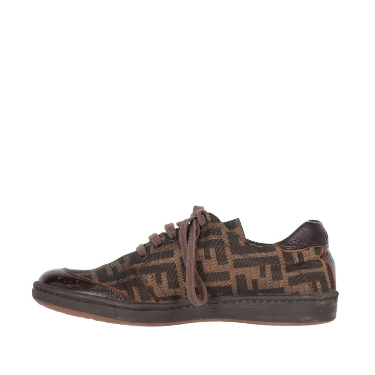 Fendi brown and beige iconic pumpkin fabric lace-up shoes with brown leather details. Round toe with rubber sole.  The item shows signs of wear on the leather and the sole, as shown in the pictures.  Years: 2000s Made in Italy Size: 37 EU  Insole: