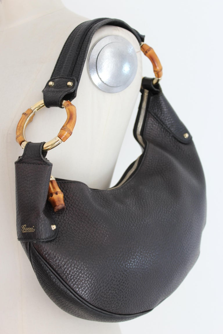 64433c1fb Gucci black leather hobo bag, half-moon shape. In fine hammered leather with