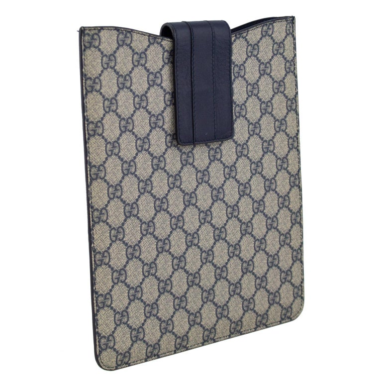 2000's Gucci iPad case/sleeve. Navy and grey all over Gucci logo leather with navy blue leather Velcro top closure. Soft black suede interior. Easy and chic way to protect your iPad. Great for travel. Excellent vintage condition. Made in Italy.