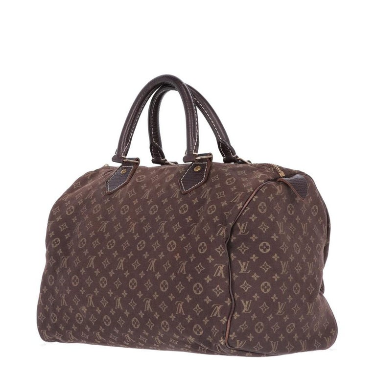Louis Vuitton brown monogram canvas bag and finished edges. Two leather handles and golden metal details. The item is vintage, it shows light signs of wear as shown in the pictures.   Years: 2000s   Made in Italy   Height: 21 cm  Width: 30 cm