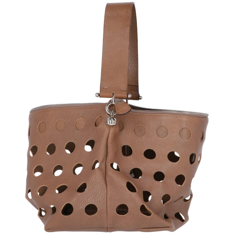 Marni soft brown leather shoulder bag, trapezoid-shaped and perforated, has a removable brown leather handle and a zip closure.  Years: 2000s  Made in Italy  Width: 42 cm Height: 24 cm Depth: 22 cm Handle: 48 cm