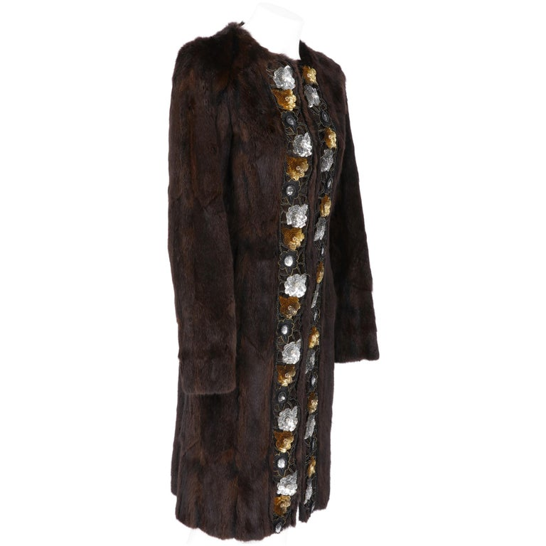 Miu Miu round neck long soft hamster fur coat dyed in brown color, with long sleeves, hooks and eyes fastening, frontal hidden pockets, shiny sequins and beads floral embroidery and unlined interior.  Please note this item cannot be shipped outside