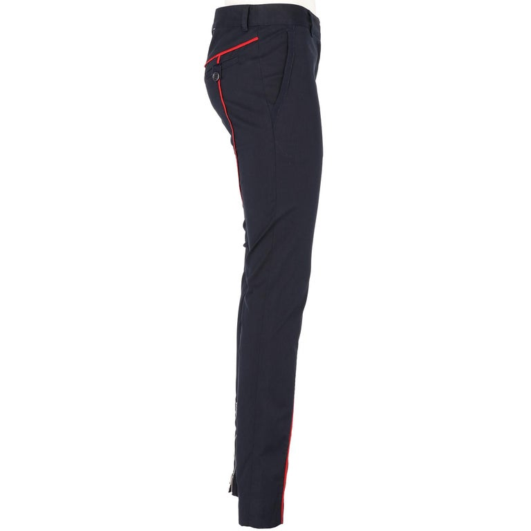 Moschino Cheap and Chic carrot trousers in dark blue cotton blend with contrasting red inserts on the legs and back. Zip details on the bottom.  Years: 2000s  Made in Italy  Size: 42 IT  Linear measures  Height: 102 cm Waist: 42 cm