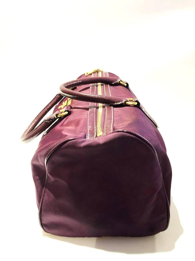 Rare Prada purple tessuto nylon double handle bag, top zipped closure, gold tone metal ware, purple patent leather details, inside tag, the bag is in very good condition, handles and goldware intatc and no discoloration   Condition: very good,
