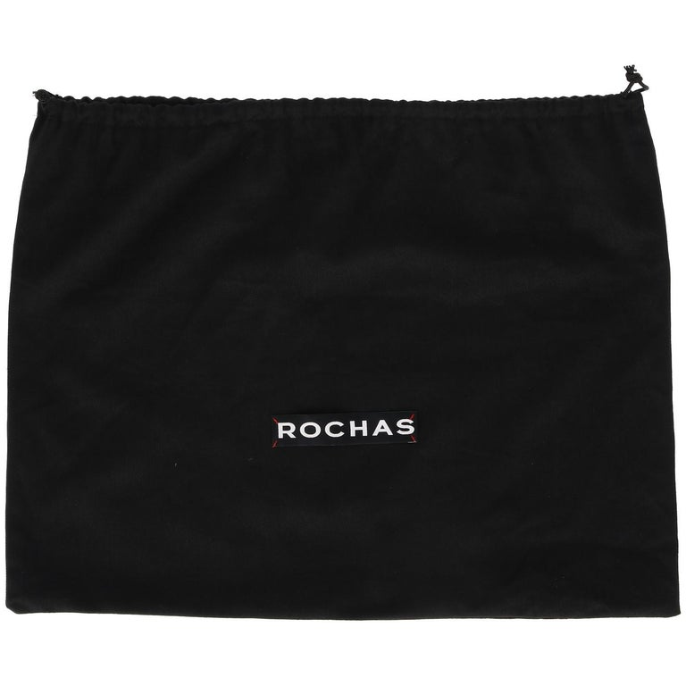The stylish Rochas clutch features a shiny brown beige and camel animalier print calf hair and soft black leather details.  With front zip pocket and zip fastening, the bag is embellished by the black leather decorative lace with one minimal bow.