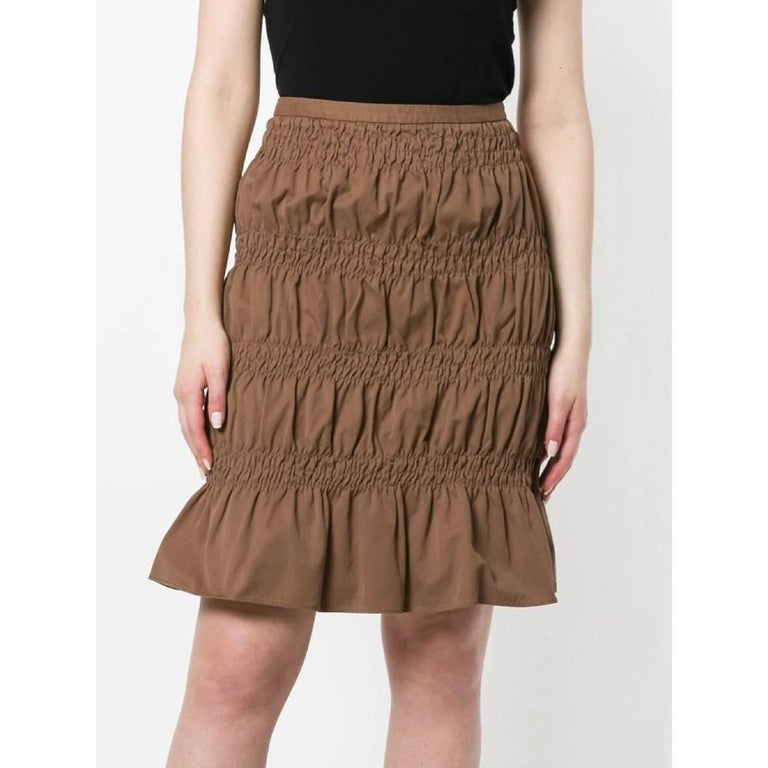 Romeo Gigli brown cotton skirt with decorative curls. High waist, below the knee length. Zip closure on the side. Years: 2000s  Made in Italy  Size: XS  Flat measurements  Lenght: 56 cm Waist: 36 cm