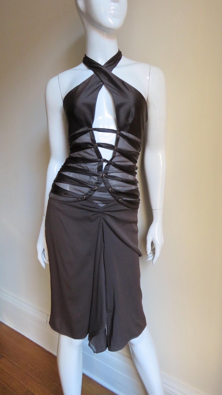A gorgeous rich brown silk halter dress by Tom Ford for Gucci.  It has a deep plunging front crossing halter neckline.  It is sheer from below the bust through to the hips round the circumference of the dress (except for the center back which is