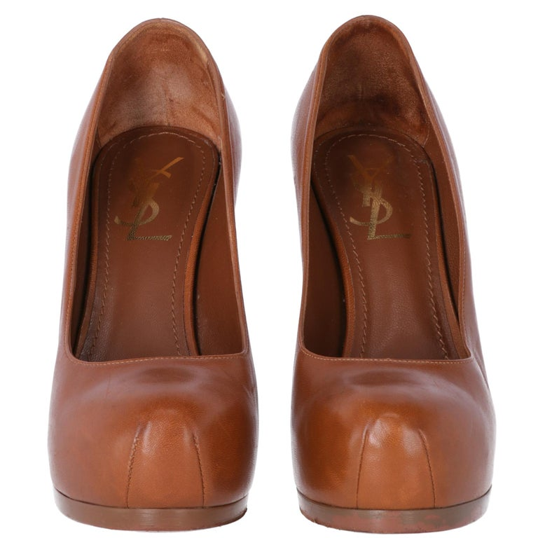 Yves Saint Laurent genuine brown leather fashionable Tribtoo pumps with almond point and two seams. Stiletto heel, outer thin platform and inner invisible platform.  Brown genuine leather insole and gold printed logo. Serial number printed