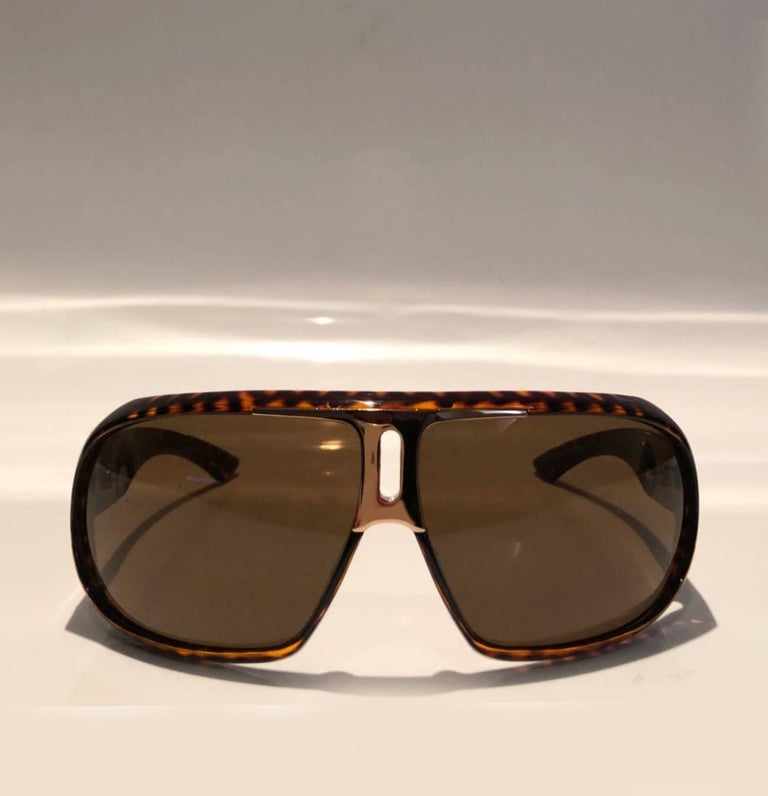 Yves Saint Laurent Havana Brown full rim sunglasses, brown scratch/impact-resistant lenses, sturdy plastic frame, gold tone metal ware, 100-percent UVA and UVB protection, Model: 2199/S, Made in Italy    Condition: pre-owned, like
