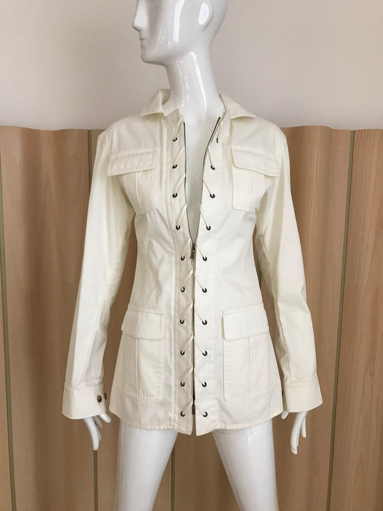 Yves Saint Laurent white cotton long sleeve safari style Jacket with zipper unworn with store tag. Fit size 4. Jacket marked F36