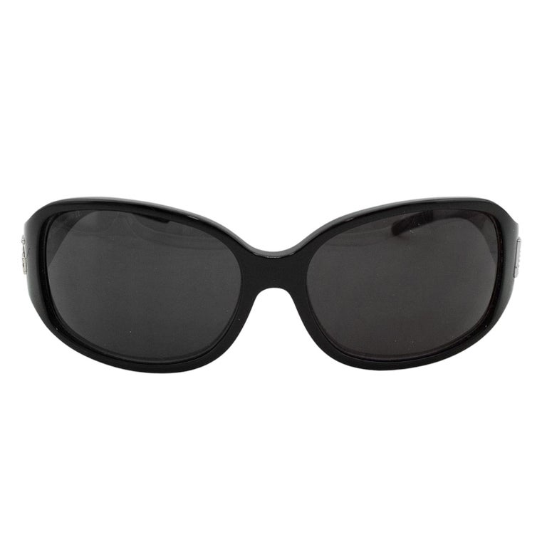 Dolce and Gabbana sunglasses from the early 2000s. Black with black gradient lenses. Silver metal DG logo at temples embellished with rhinestones. Excellent vintage condition. Sold with case. Made in Italy.