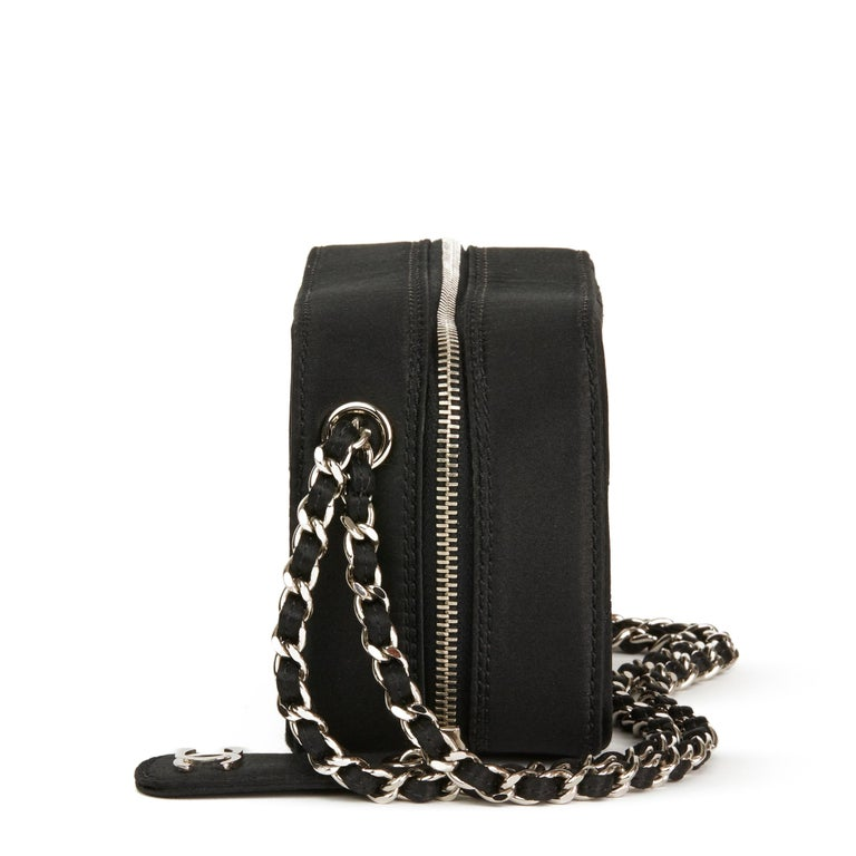 CHANEL Black Quilted Satin Mini Timeless Wristlet  Reference: HB2855 Serial Number: 6259400 Age (Circa): 2001 Authenticity Details: Serial Sticker (Made in Italy) Gender: Ladies Type: Wristlet, Clutch  Colour: Black Hardware: Silver Material(s):