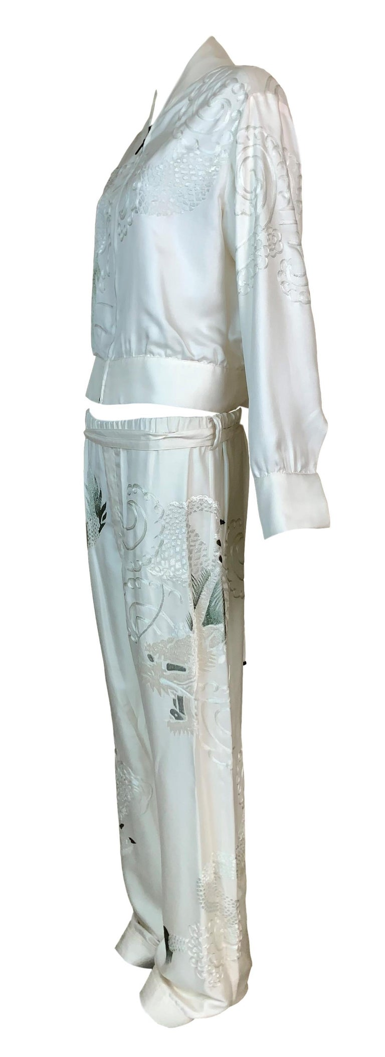 DESIGNER: 2001 Gucci by Tom Ford  Please contact for more information and/or photos.  CONDITION: Good-there is a pin dot near the seam at the crotch, its not seen when worn and extremely minor- please see last photo.   FABRIC: Silk  COUNTRY MADE: