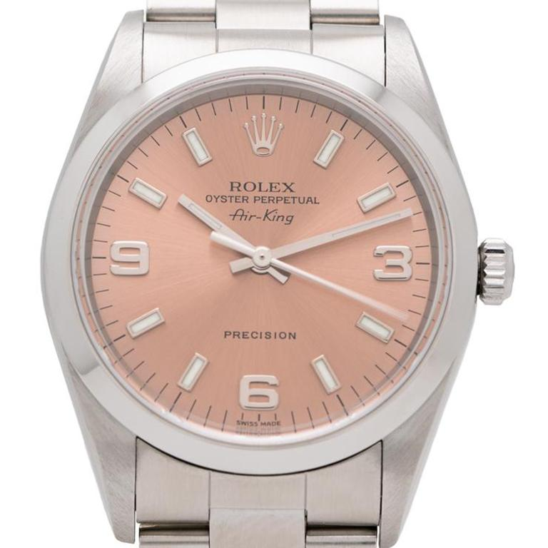 2001 Rolex Air King Model 14000m  Additional Information: Maker: Rolex Model: 14000M Year: 2001 Material: Stainless Steel Dial: Original Salmon Movement: Automatic Case Measurement: 34mm Weight: 89g Size: Fits up to a size 8 Adjustable Condition: