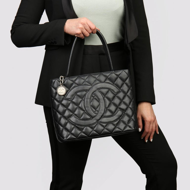 CHANEL Black Quilted Caviar Leather Vintage Medallion Tote   Xupes Reference: HB3753 Serial Number: 6795470 Age (Circa): 2002 Accompanied By: Authenticity Card, Care Booklet  Authenticity Details: Authenticity Card, Serial Sticker (Made in France)