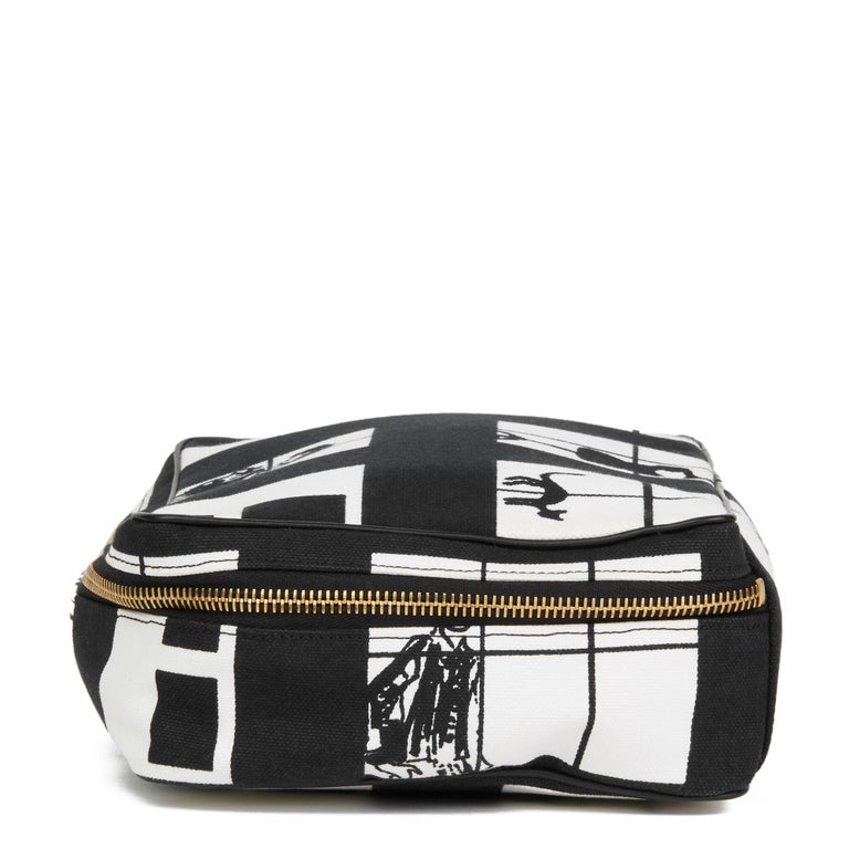 CHANEL Black & White Canvas 'Window Line' Toiletry Pouch  Reference: HB2721 Serial Number: 8241442 Age (Circa): 2002 Authenticity Details: Serial Sticker (Made in Italy) Gender: Ladies Type: Accessory, Travel  Colour: Black, White Hardware:
